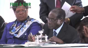 President Mugabe Signs New Constitution - YouTube